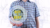 аукцион : Young man shows a hologram of the planet Earth and text Buy or rent. Boy with future technology 3d projection on a modern white digital background