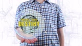 destino : Young man shows a hologram of the planet Earth and text Change your destiny. Boy with future technology 3d projection on a modern white digital background Stock Footage