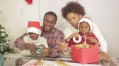 ribbon : Black family with christmas gifts