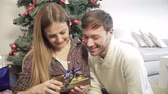 celebration : Couple opening chrismtas presents