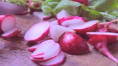 fresh radishes on wooden table, cutting