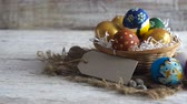 пасхальное яйцо : Easter decoration. Woman in a basket. traditional easter decoration