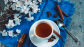 herbata : Apricot flowers and tea cup. Spring atmosphere.