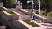 созерцательный : Young woman descends stone stairs in a sity parck