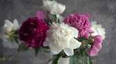 estilizado : Bouquet of colored peony in vase. Fresh garden peonies.