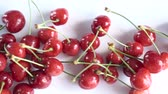 группа объектов : Group of Ripe Juicy Red Cherry on the White Background. Dolly shot. Стоковые видеозаписи