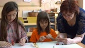 sólido : A teacher and four children. the teacher teaches students to model plasticine Stock Footage
