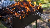 çatırtı : Preparing for barbecue - wood burning in the metal barbecue grill
