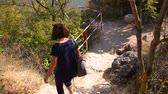 monastic : Woman Moving On The Old Stone Steps Of Ancient monastery in stone Stock Footage