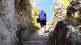 Woman Moving On The Old Stone Steps Of Ancient monastery in stone Stock Footage