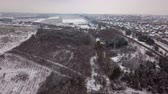 libano : Flight over the nature and village. Snow-covered forest. Rural landscape. Flight over the winter landscape Filmati Stock