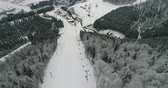 альпинист : View from the drone on the ski slope on the borders near the ski lift in winter 4K Ultra HD