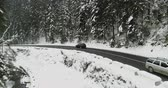 au volant : The car passes on a snow-covered road in the mountains 4K Ultra HD