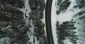 au volant : Aerial view of a car passing on the road in the snowy mountains near the river 4K Ultra HD