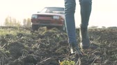 girl left : Girl threw the car in the field, A girl is walking along the field,womens shoes