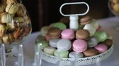 przetwory : Cupcakes with cream and macaroon cookies on a beautiful sweets table.close-up