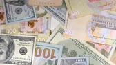 hryvnia : Money rotate on the table. Denominations. Dollar and hryvnia