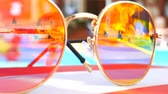 Sunglasses. Pool reflection. Concept of holiday at sea. Observations children, play. TimeLapse. Stock Footage