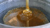 extractor : Honey from the honey extractor is filtered through the feed to concrete
