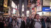 kamu : Manhattan - New York - October 8, 2013: Tourists on always busy Time Square Stok Video