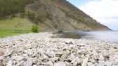 junção : stone shore of Lake Baikal (Olkhon island) Stock Footage