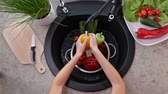 Child hands washing vegetables for a salad - the yellow bellpepper, top view  of the kitchen sink