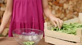 Young girl hands shelling peas - camera slide