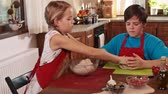 Kids at home making a pizza - portioning the dough Wideo
