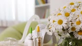 tlen : Nebuliser inhaler device revealing from behind daisy bouquet, allergy concept - rack focus, camera dolly