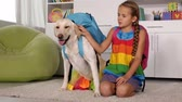Girl playing with dog - with scghoolbags on their backs, ready for school