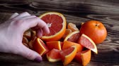 citrus fruit dish : the pile of citrus and woman hand Stock Footage