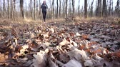 selülit : Motivated fat girl runs through the autumn forest to fight overweight