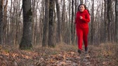selülit : Overweight girl runs through the autumn forest to fight overweight.Finish.
