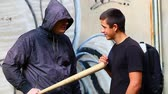 vandal : Man with a baseball bat against teenager with a backpack episode 4 Stock Footage