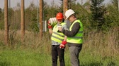 jacket : Electrician Engineer explains to worker assigned work