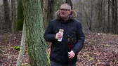 fitness : Hiker with thermos near tree in the park