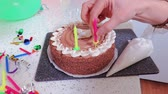 celebration : Woman holds candle for birthday party cake in her hands