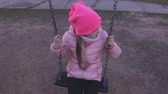 hinta : Lonely little girl on the swing