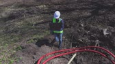 vesta : Woman engineer near cables in plastic pipes Dostupné videozáznamy