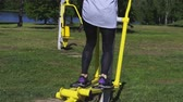 adım : Woman using stepper training machine at park