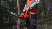 lumber industry : Logger try to start chainsaw Stock Footage