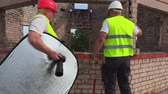 meslek : Builders are going to take photos on construction site Stok Video