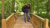 men : Man take photos on wooden bridge in park