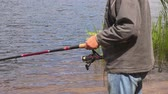 rybak : Man keeping fishing rod Wideo