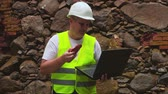 examine : Engineer with sample of old brick wall