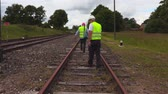 kolej : Railway staff checks railway condition