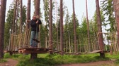 engel : Man in rope course aerial park Stok Video