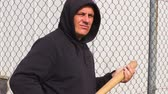 morcego : Man with a baseball bat near fence Stock Footage