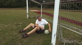 drible : Disappointed soccer goalkeeper at the soccer football field gates Stock Footage