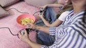 empolgante : Family relaxed with PC game at home Stock Footage
